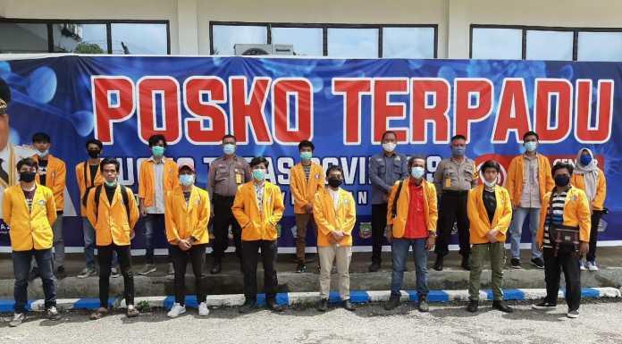 Bersatu Perangi COVID-19, BEM UHO Lakukan Aksi Sosial Bersama Polda Sultra, TNI dan Gugus Tugas Covid-19